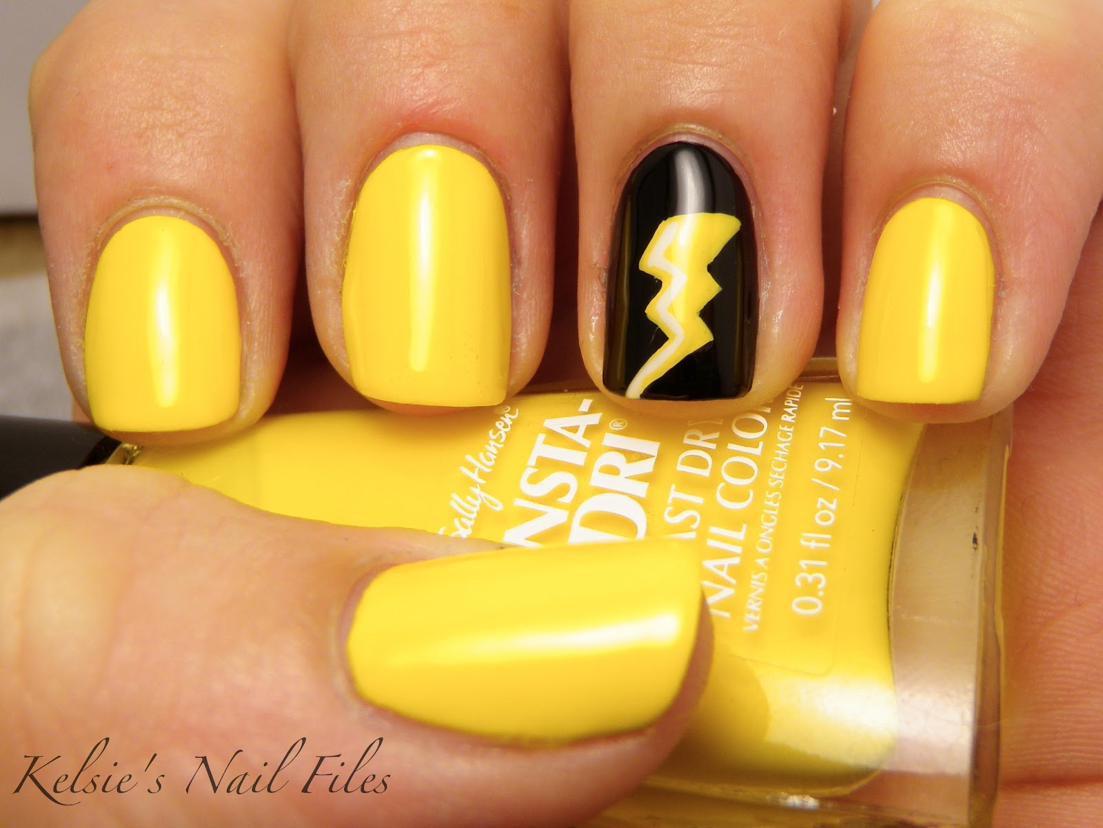 Yellow nails with a lightning bolt accent