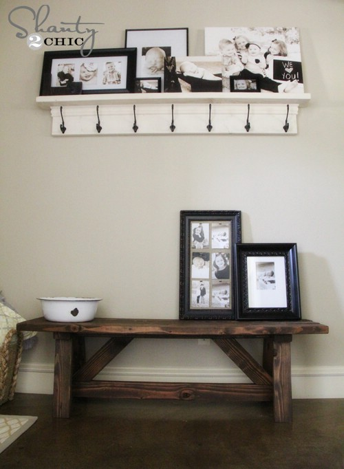 Stained, rustic wooden entryway bench