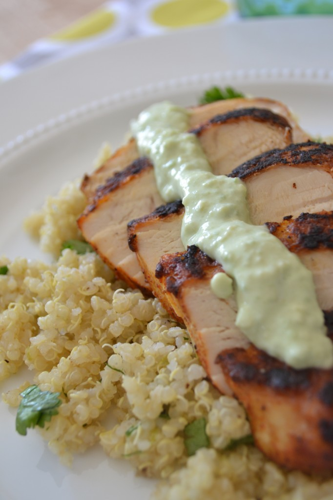 Blackened chicken breast over cilantro lime quinoa with greek yogurt avocado puree