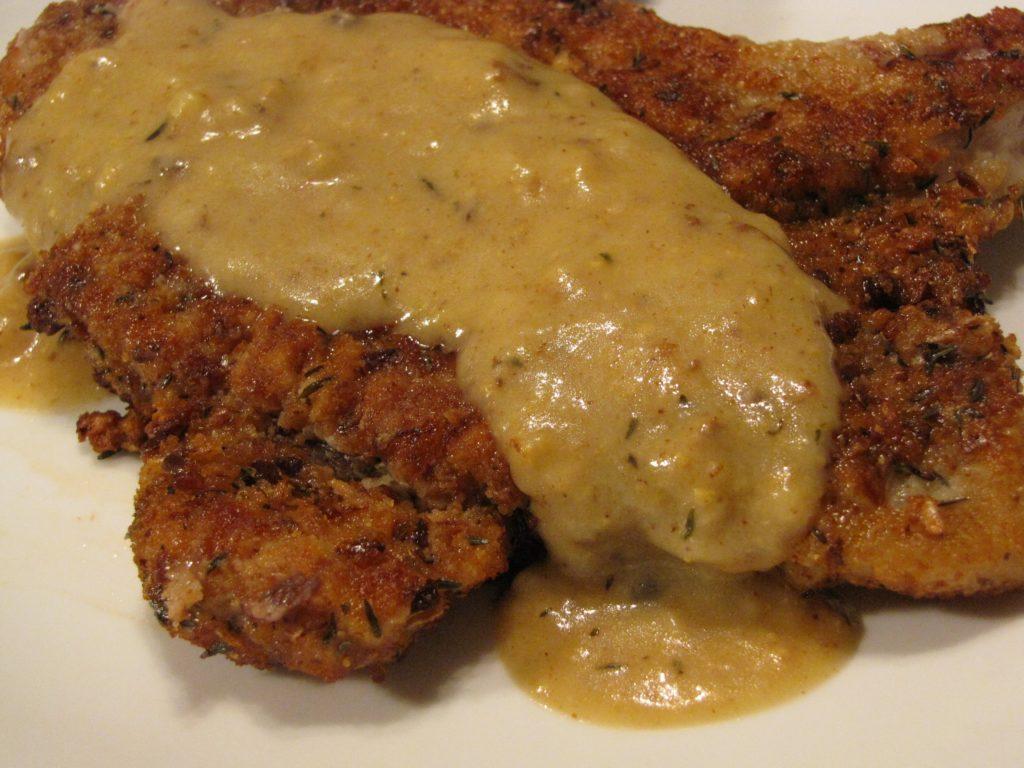 Chicken fried pork chops with mustard sauce