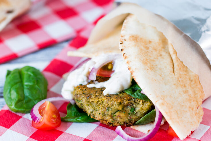 Who needs meat! This spicy falafel wrap with sriracha tzatziki makes THE BEST lunch!