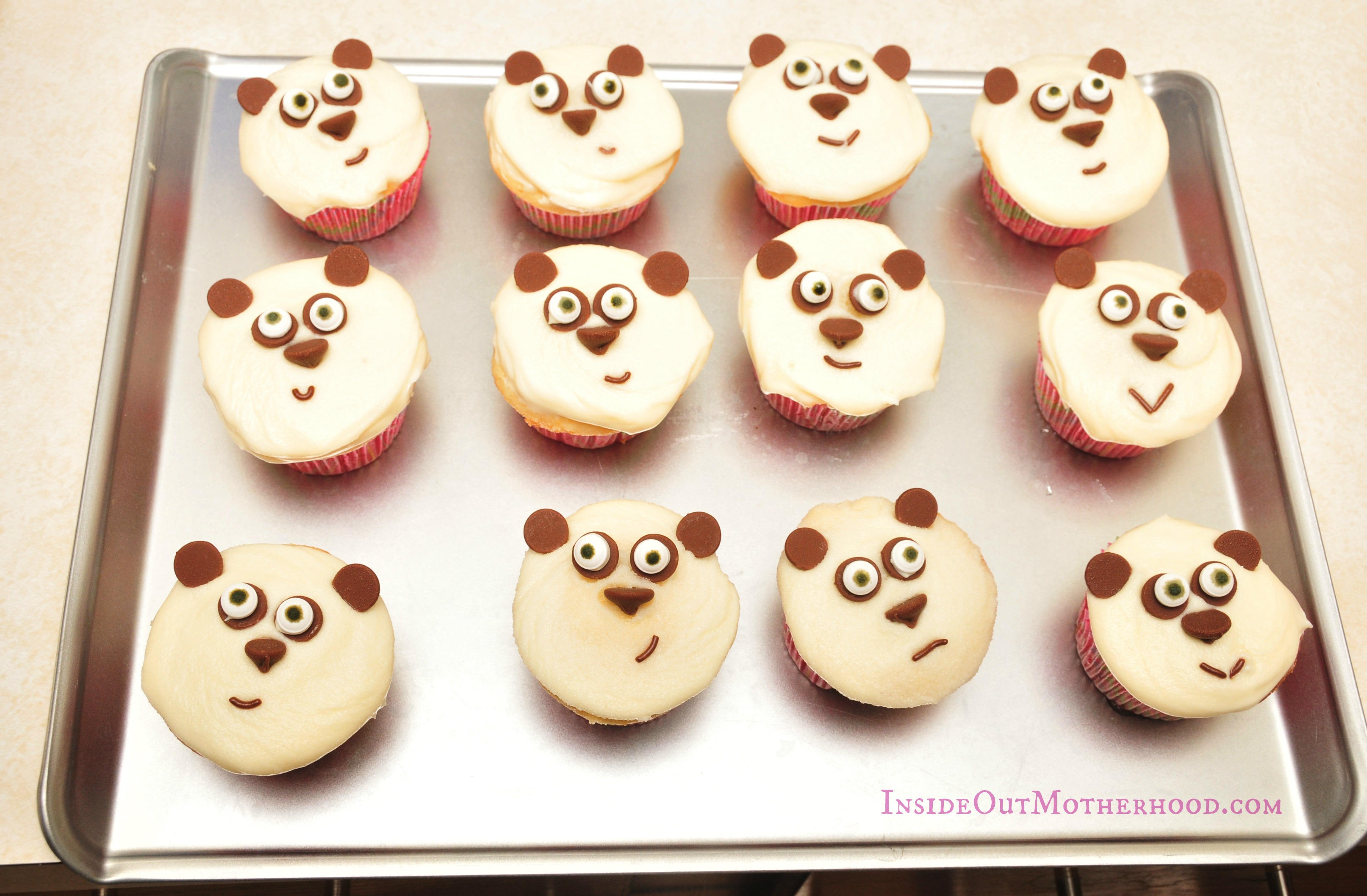 Panda cupcakes on cookie sheet