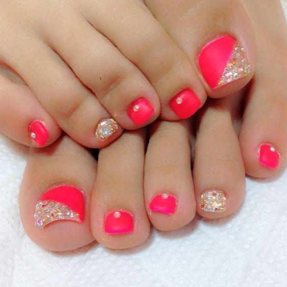 Coral rhinestone toe nail design