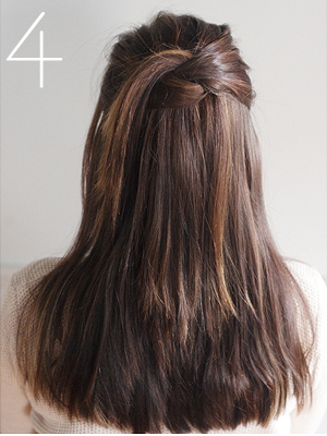 Knot and toss half up hairdo
