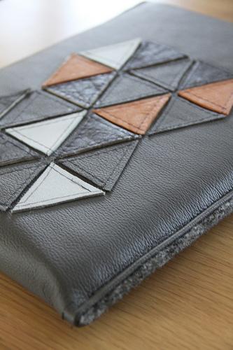 Geometric leather sleeve
