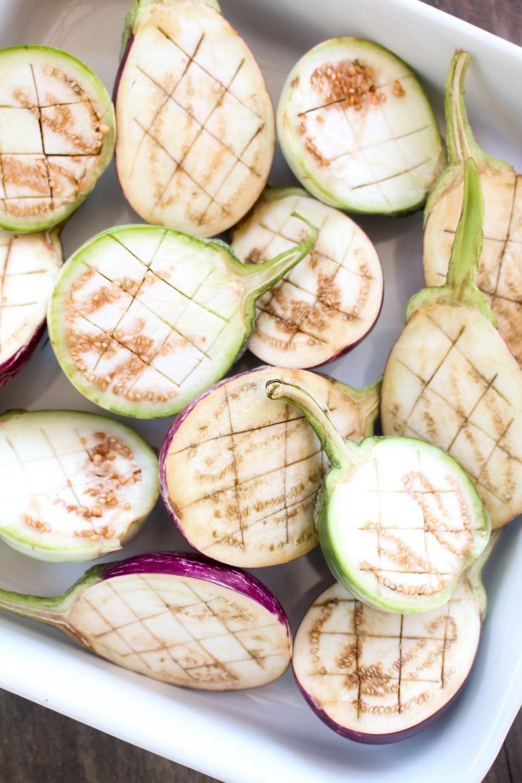 Slow roasted eggplant with hummus and tomato jam half cut
