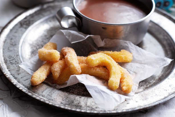 Churros con chocolate caliente churros with hot chocolate 23060 l