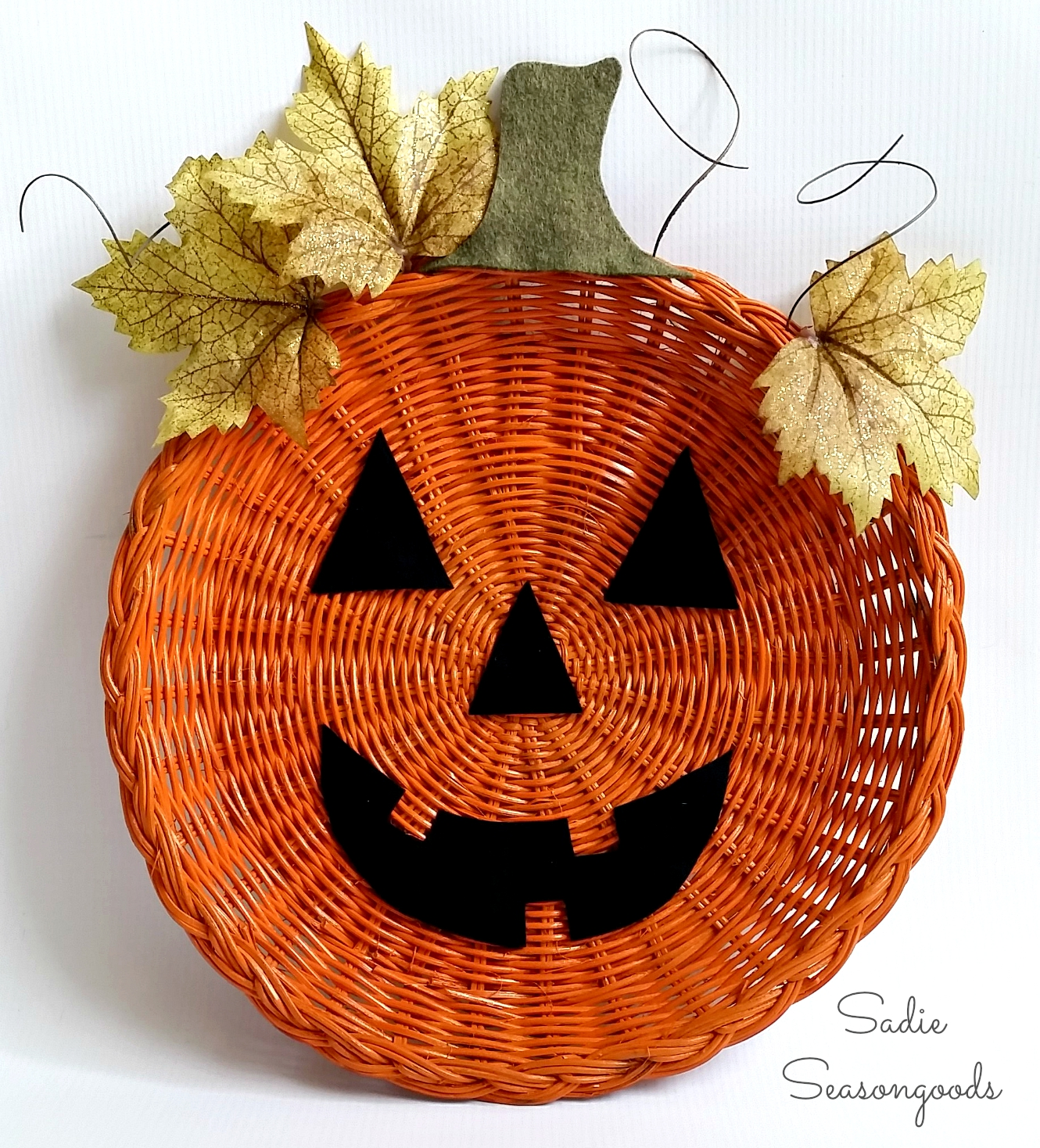 Wicker rattan charger paper plate holder pumpkin jack o lantern door hanger halloween sadie seasongoods