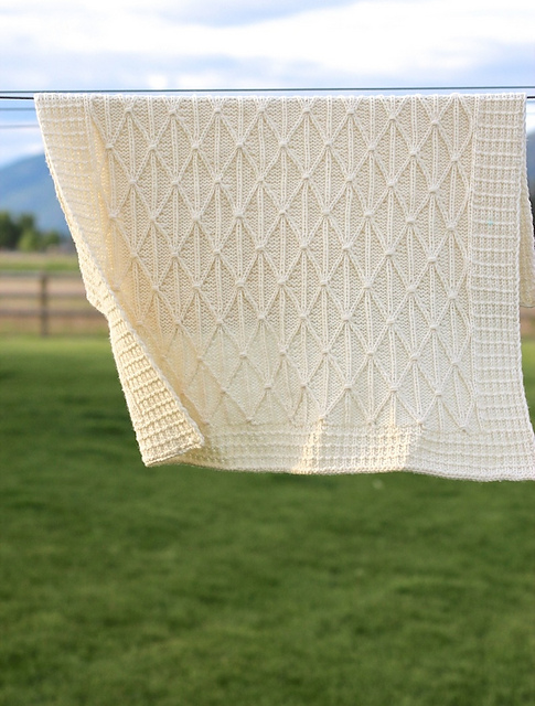 Criss cross applesauce stroller blanket