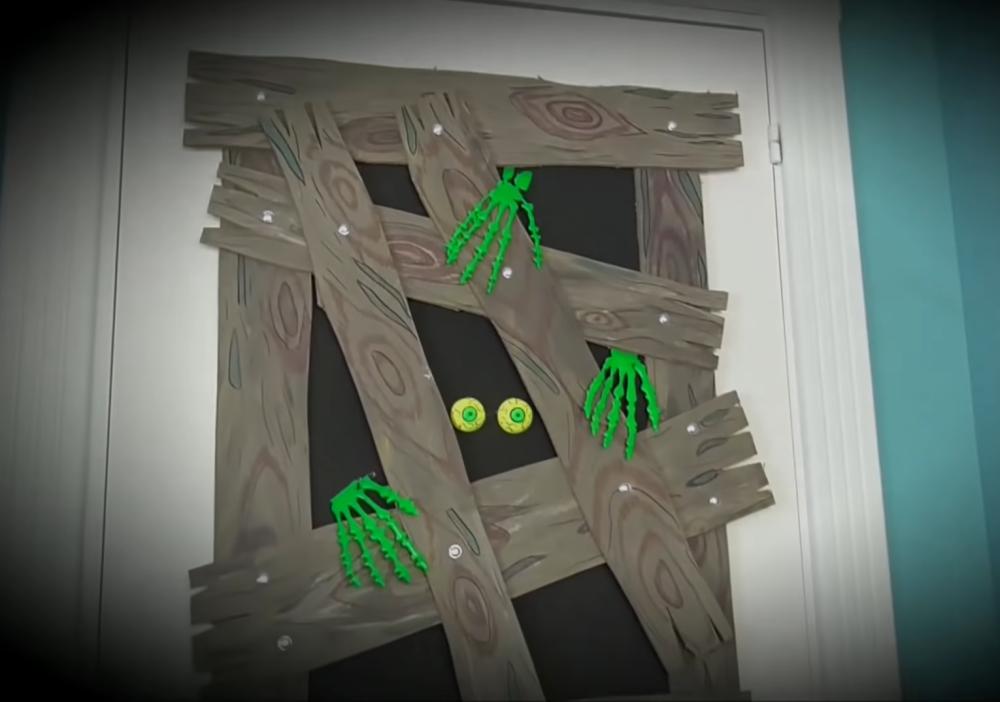Halloween door decoration zombie attack