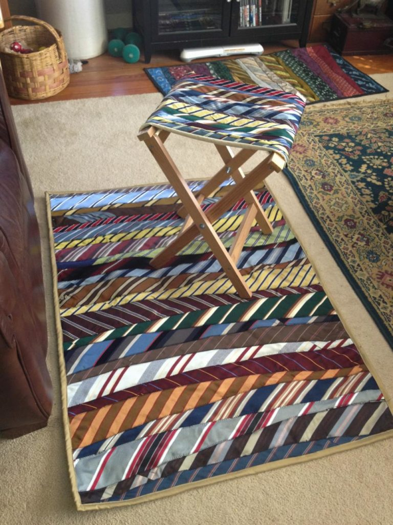 Neck tie area rug and stool