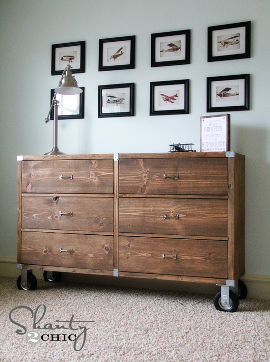 Rustic wooden dresser with wheels