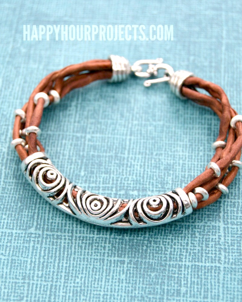 Silk and silver layered tube bead bracelet