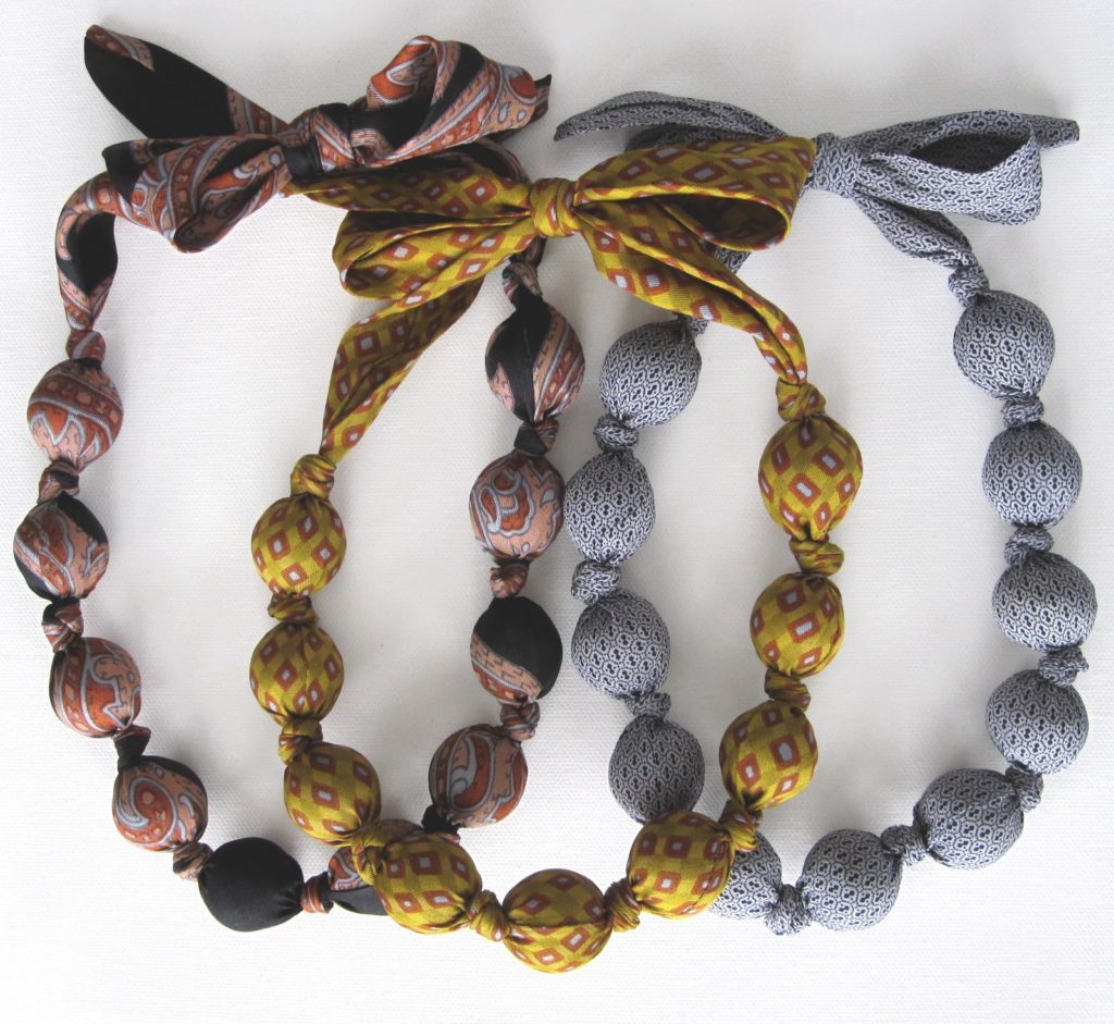 Tie covered beaded necklace