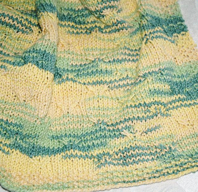 Tucked stroller blanket