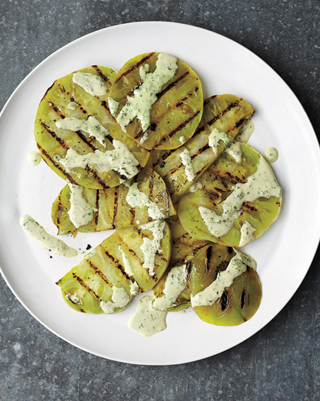 Grilled green tomato with creamy basil sauce