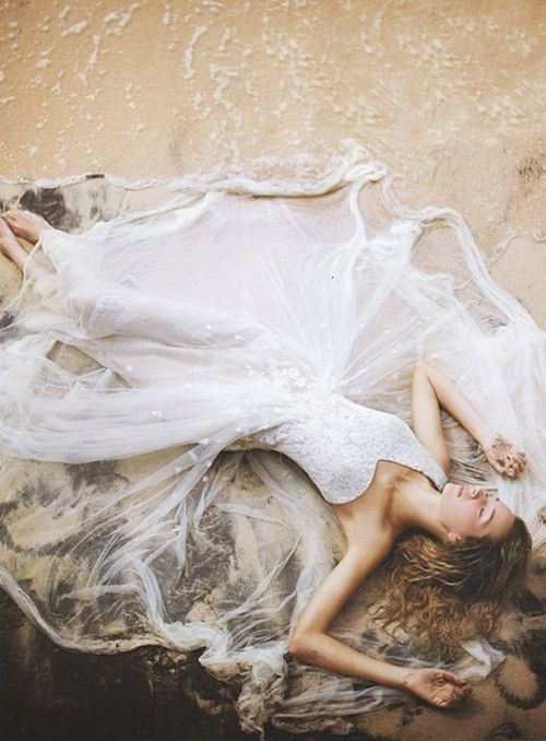 Laying in sand trash the dress