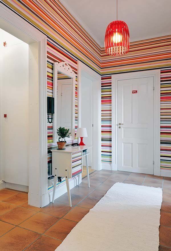 Rainbow stripe wallpaper entryway