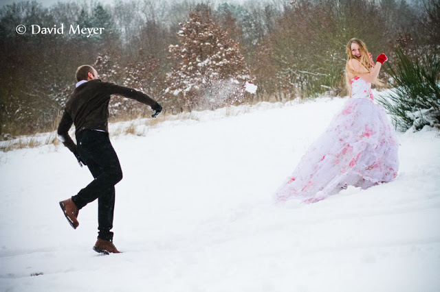Snow ball fight trash the dress