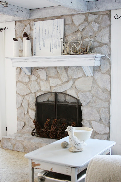 Antler and birch painting mantel
