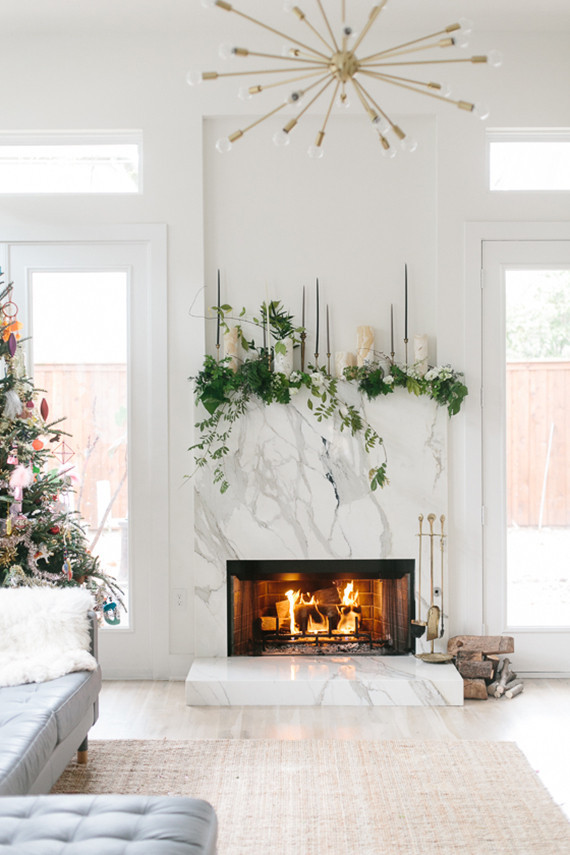 Candles greenery mantel idea
