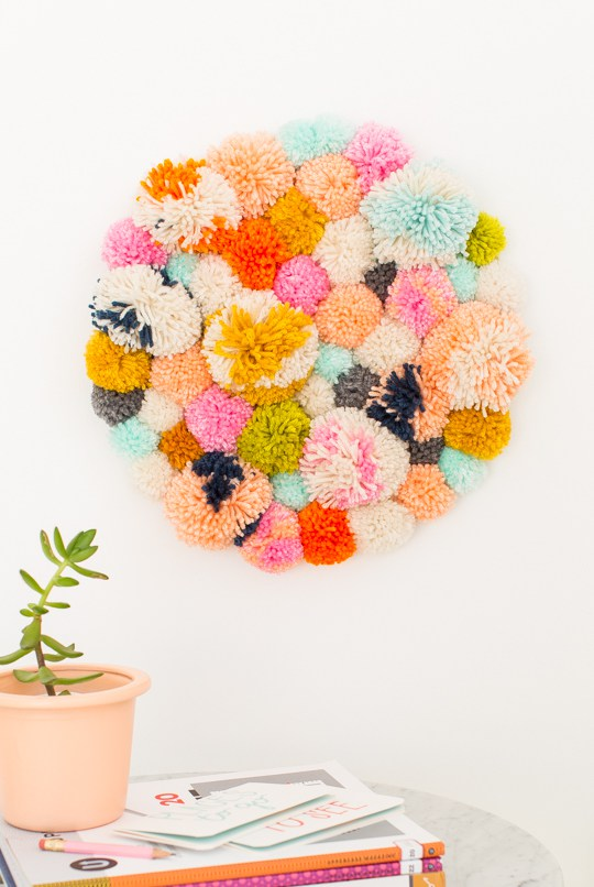 Circular pom pom wall hanging