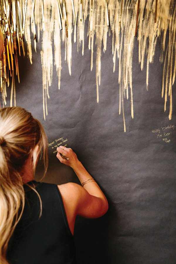 Gold pen guestbook wall