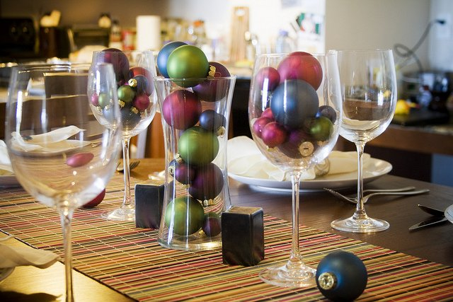 Holiday ornaments and wine glasses photo