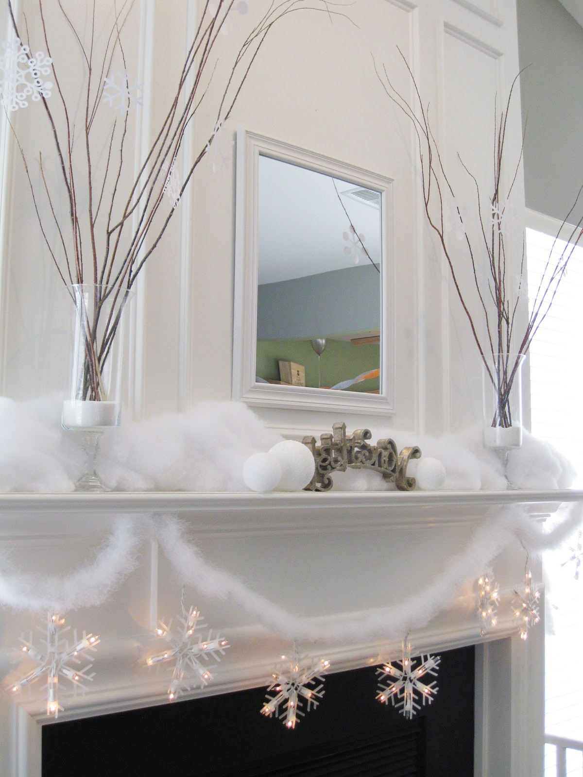 Snow and twig mantel decor