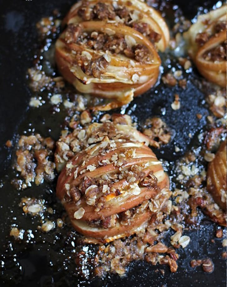 Hasselback baked apples with brie and pecans