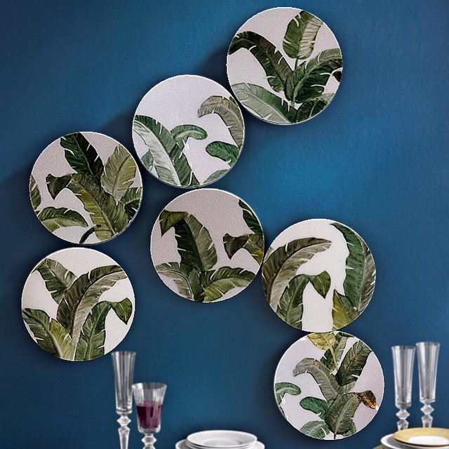 Dishes with leaves on wall