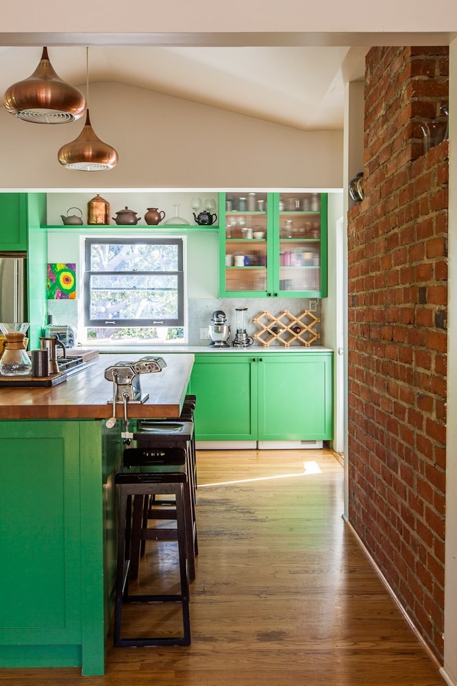 Green and brick kitchen