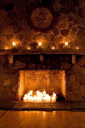 Candles inside fireplace design idea