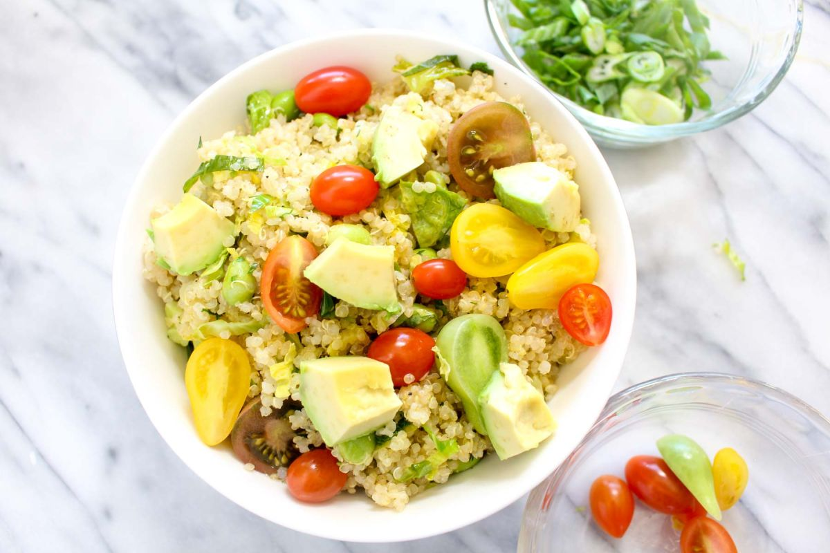 Savory quinoa breakfast bowl cherry tomatoes and avocado