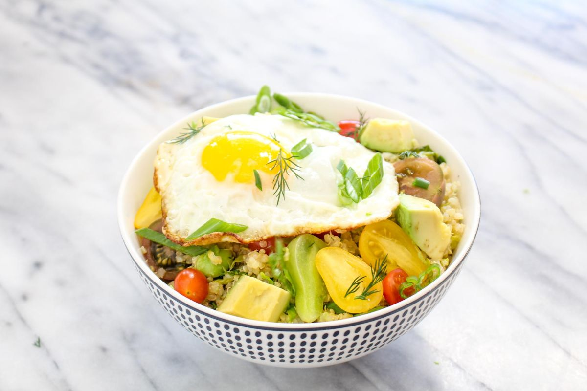 Savory quinoa breakfast bowl fried egg and serve