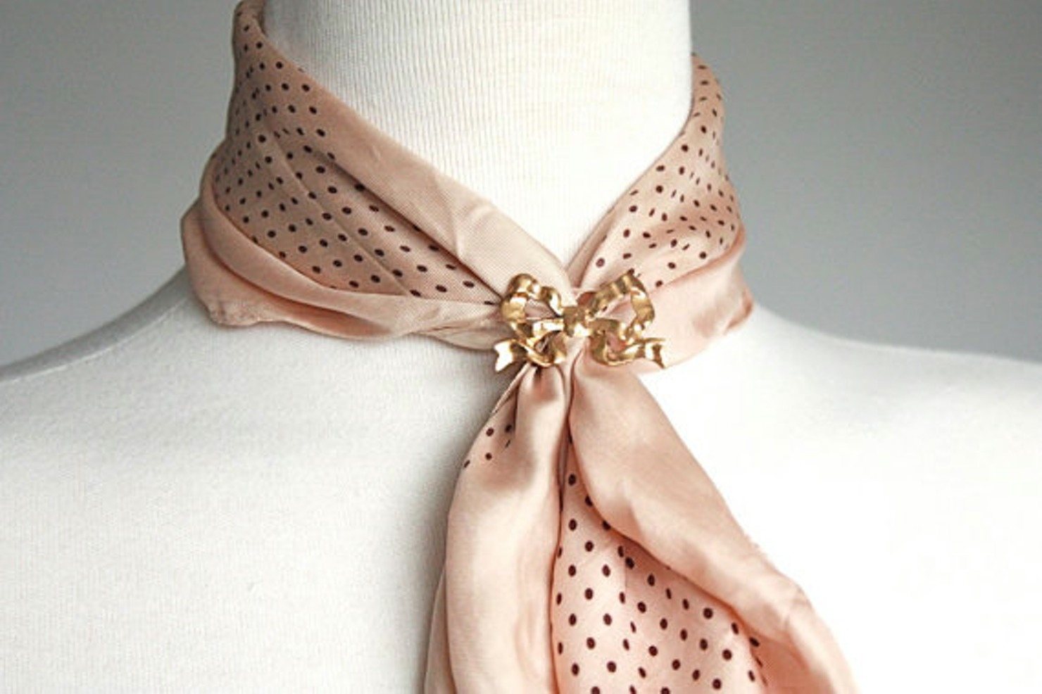Tie a scarf with a brooch