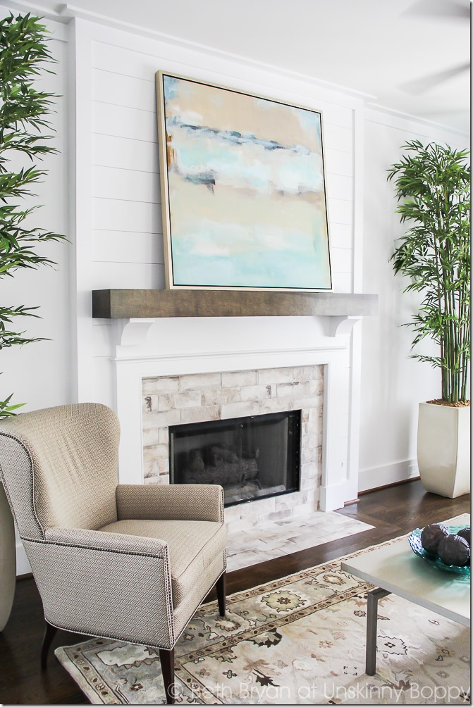 Watercolor print fireplace mantle decor idea