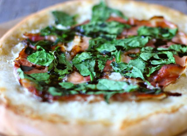 Prosciutto pizza with truffle oil
