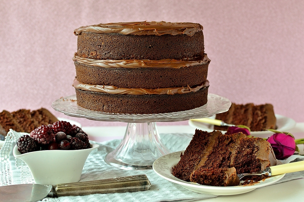 The ultimate chocolate layer cake - a rich, moist, fudgy chocolate cake filled with smooth chocolate ganache, the ultimate treat!