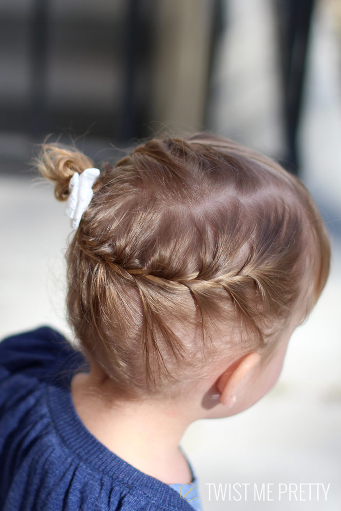 Braided side bun toddler hairstyle
