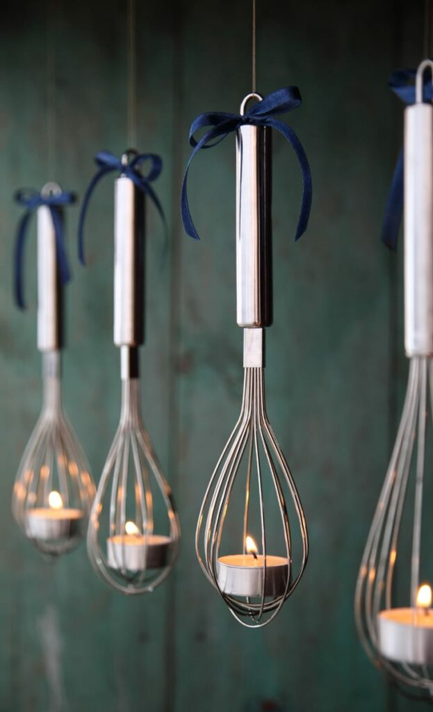Hanging whisk candle holding