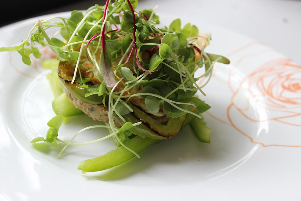 Mushroom veggie burger with fried egg and microgreens