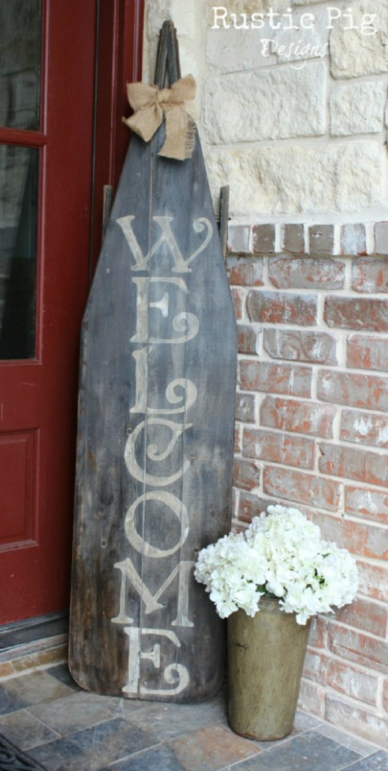 Old wooden ironing board welcome sign