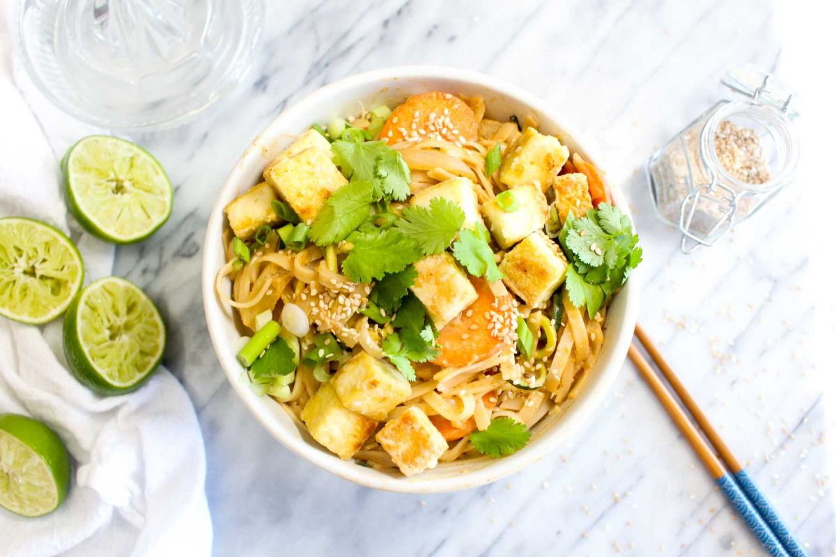 Peanut sauce noodles with crispy tofu top with tofu