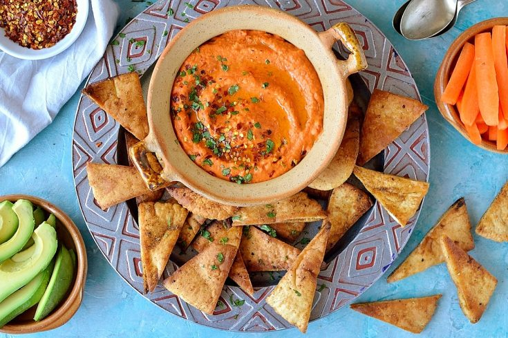 Roasted red pepper and chilli hummus with home-made pitta chips - quick and easy to make and an ideal snack!
