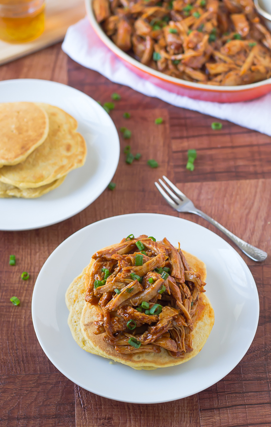 Slow cooker honey pulled pork recipe over cornmeal pancakes