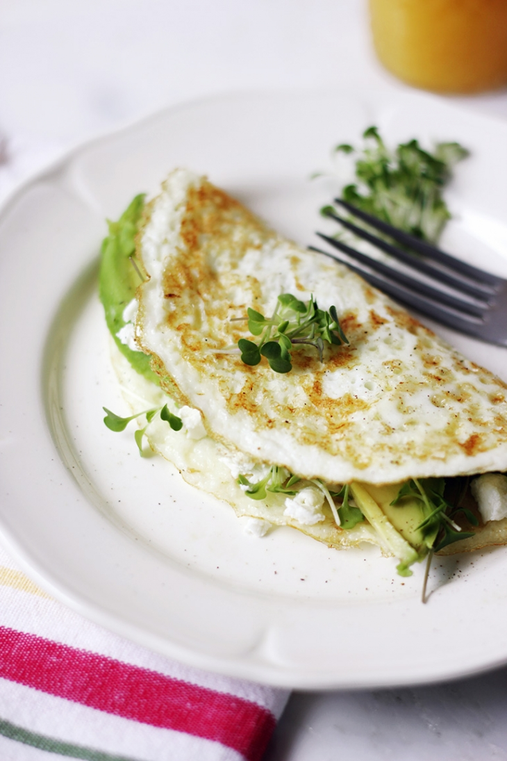 Egg white omelette with avocado goat cheese and microgreens