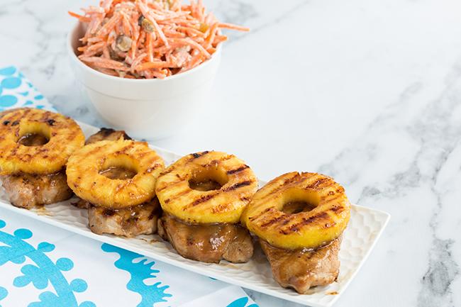Grilled pineapple teriyaki pork chops with carrot and raisin