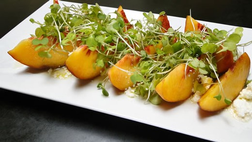 Peach and goat cheese salad with kale microgreens