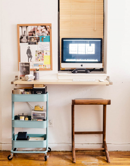 Wall mounted desk with windowsill